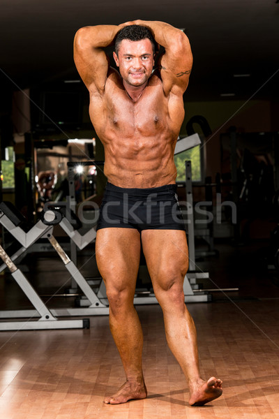 muscular body builder showing his front abdominal abs Stock photo © Jasminko