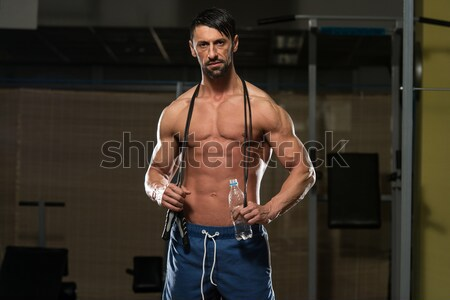 Young Bodybuilder Flexing Muscles Isolate On Black Blackground Stock photo © Jasminko