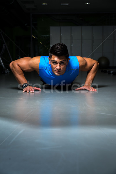 Man exercising in gym push ups Stock photo © Jasminko