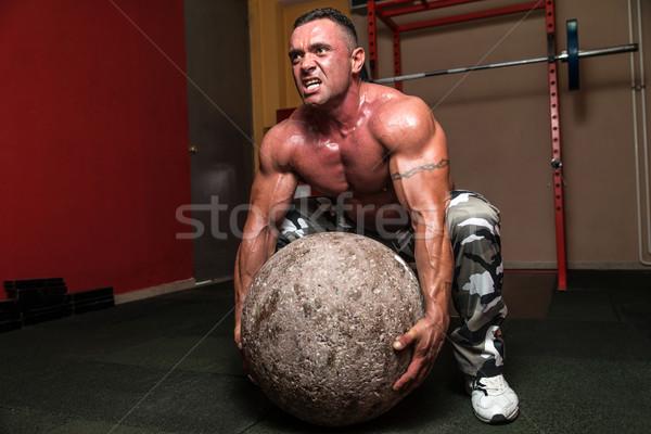 Bodybuilder Trying To Pick Up A Stone Stock photo © Jasminko