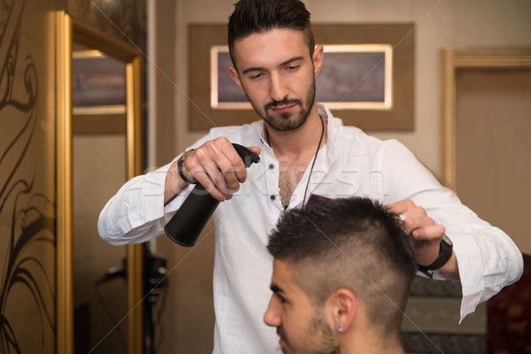 Male Hairstylist Water Sprayer On Hair On Hair Stock photo © Jasminko