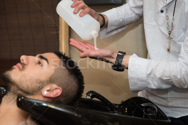 Portrait Of Male Client Getting His Hair Washed Stock photo © Jasminko