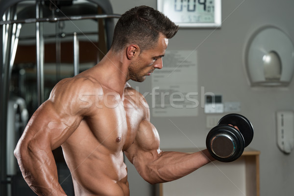 Jeune homme biceps concentration sport Photo stock © Jasminko