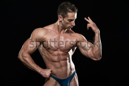Portrait Of A Bodybuilder Isolate on Black Blackground Stock photo © Jasminko