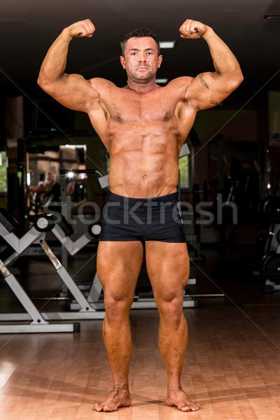 Foto d'archivio: Corpo · muscoloso · builder · fronte · raddoppiare · bicipiti
