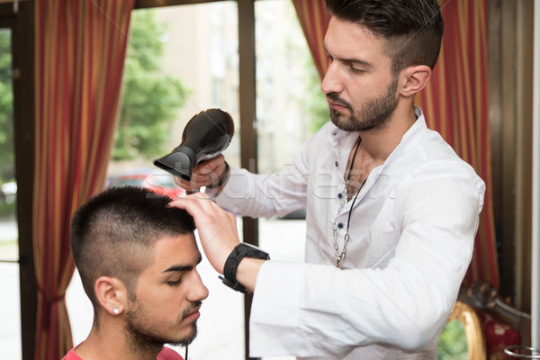 Stock photo: Hairdresser Blow Dry Man's Hair In Shop