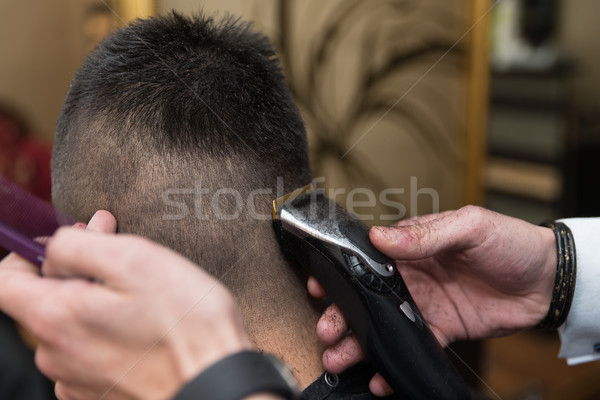 Hairdresser Making Haircut To Young Man Stock photo © Jasminko