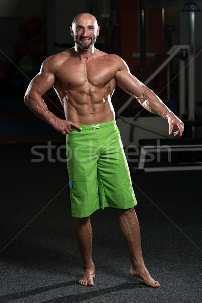 Mature Muscular Man Flexing Muscles Stock photo © Jasminko