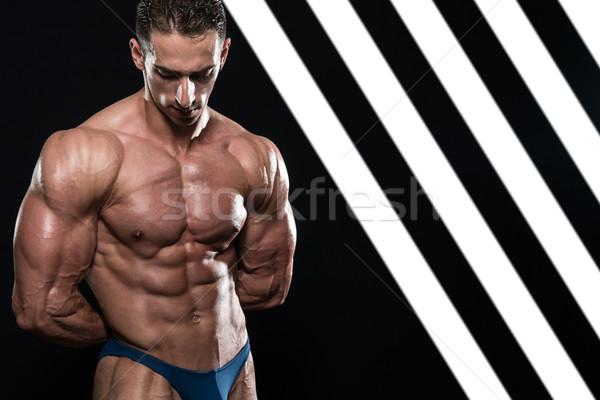 Ciddi erkekler ayakta kaslar genç vücut geliştirmeci Stok fotoğraf © Jasminko