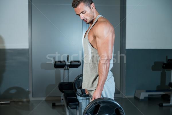 Adam ağır spor salonu vücut çalışma Stok fotoğraf © Jasminko