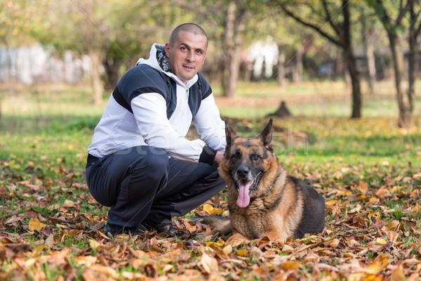 Homem cão pastor floresta masculino Foto stock © Jasminko