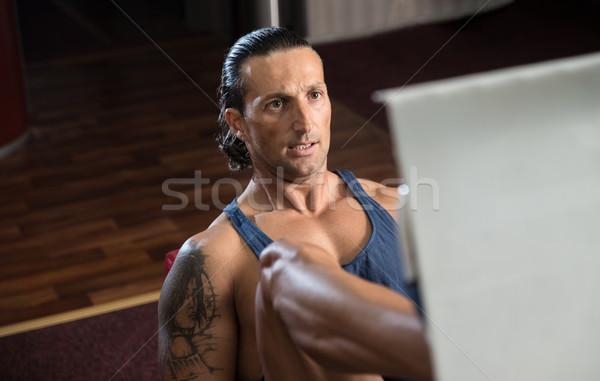 Adam bacak basın spor salonu egzersiz erkek Stok fotoğraf © Jasminko