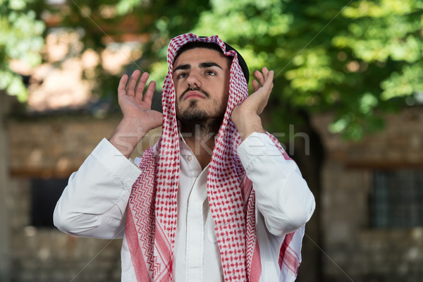 Müslüman adam dua eden cami genç Stok fotoğraf © Jasminko