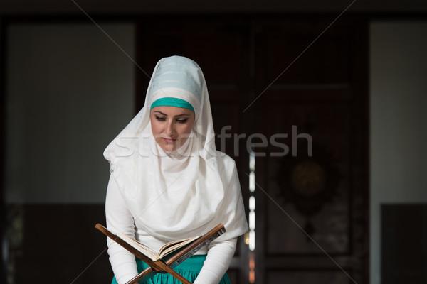 Stock photo: Muslim Woman Is Reading The Koran