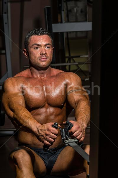 male body builder doing heavy weight exercise for back Stock photo © Jasminko