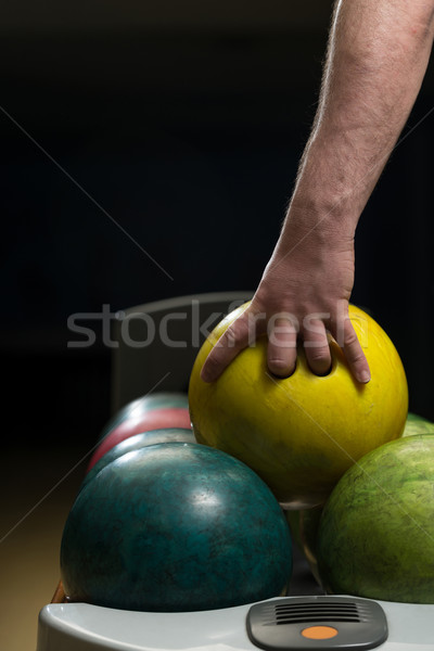 Holding Ball Against Bowling Alley Stock photo © Jasminko