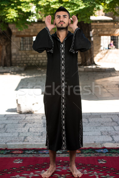 Genç Müslüman adam dua eden adam Stok fotoğraf © Jasminko