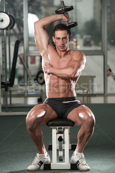 Młody człowiek triceps młodych sportowiec wykonywania Zdjęcia stock © Jasminko