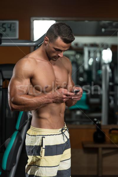 Giovane fitness ritratto mobile Foto d'archivio © Jasminko