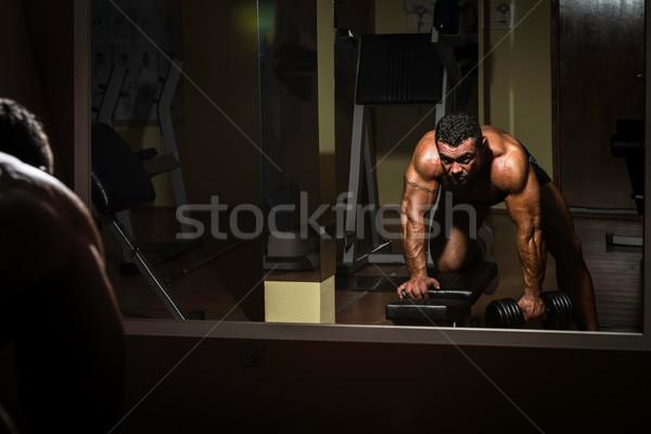 Masculino musculação pesado peso exercer de volta Foto stock © Jasminko