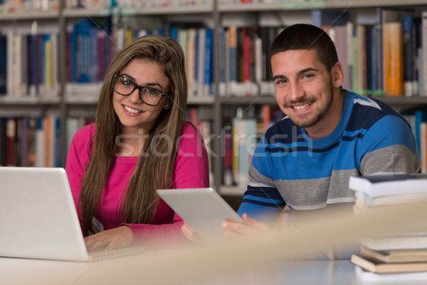Gelukkig studenten werken laptop bibliotheek knap Stockfoto © Jasminko