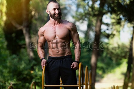 Man Showing Off His Muscle Stock photo © Jasminko