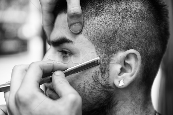 Hairdresser Shaving Man's Chin With A Straight Razor Stock photo © Jasminko