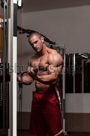 Olgun vücut geliştirmeci pazı egzersiz spor salonu Stok fotoğraf © Jasminko