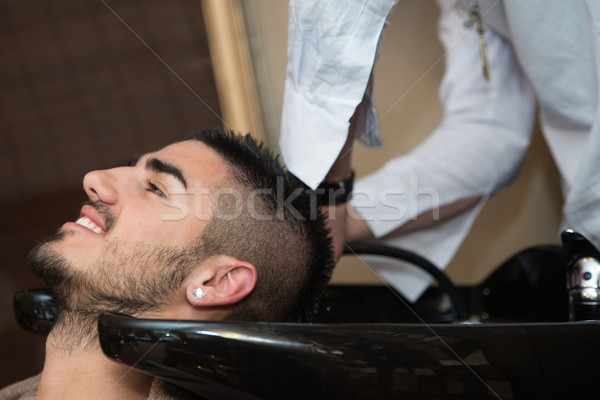 Hairdresser Washing Man Head In Barber Shop Stock photo © Jasminko