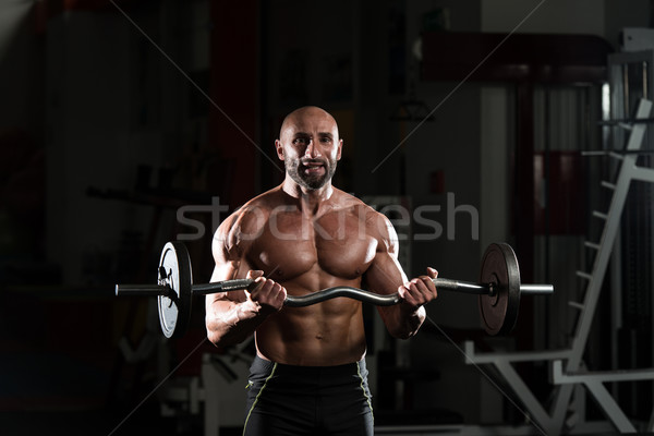 Healthy Man Working Out Biceps In A Health Club Stock photo © Jasminko