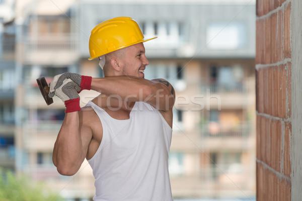 ビルダー 作業 ハンマー 爪 ハンサム 建設 ストックフォト © Jasminko