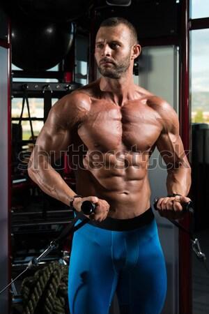 muscular bodybuilder showing his upper body Stock photo © Jasminko