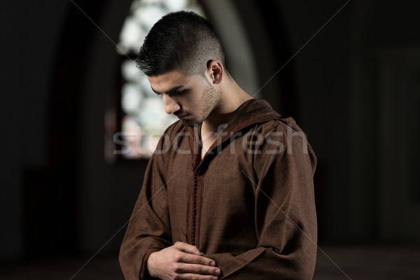 Muslim Man Is Praying In The Mosque Stock photo © Jasminko