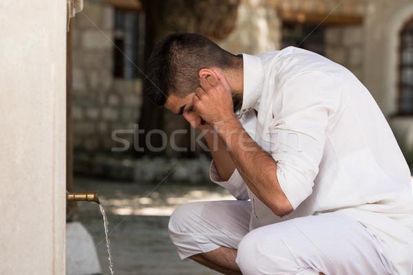 Islamic Religious Rite Ceremony Of Ablution Ears Washing Stock photo © Jasminko