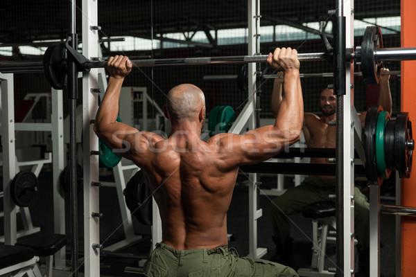 Omuz makine olgun adam spor salonu karanlık erkek Stok fotoğraf © Jasminko