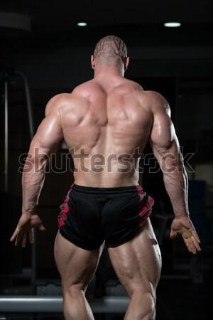 Kas erkekler kaslar siyah genç vücut geliştirmeci Stok fotoğraf © Jasminko