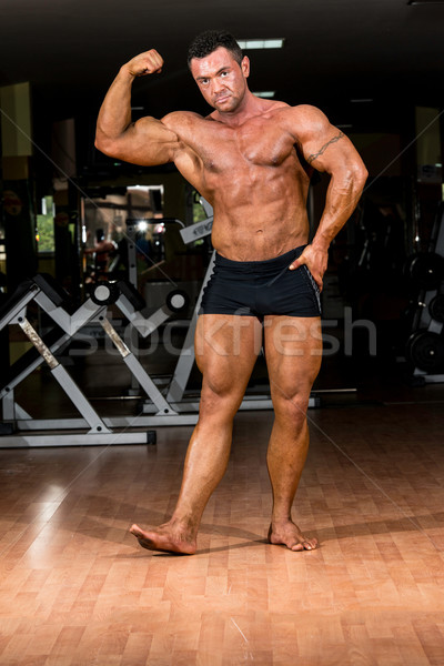 muscular body builder showing his biceps Stock photo © Jasminko