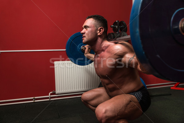 Barbell man sport gymnasium mannen oefening Stockfoto © Jasminko
