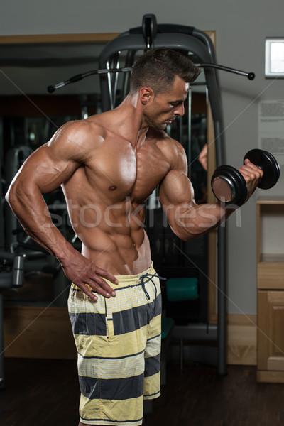 ボディービルダー 行使 上腕二頭筋 ダンベル 若い男 ストックフォト © Jasminko
