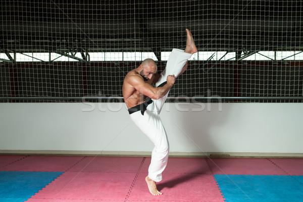 Mature Man Makes A Kick In Kimono Stock photo © Jasminko