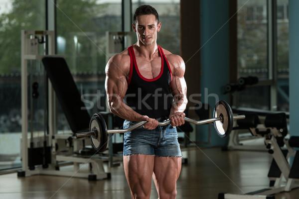 Musculação bíceps barbell muscular homem Foto stock © Jasminko