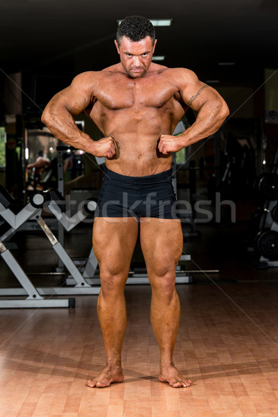 muscular body builder showing his front lat spread Stock photo © Jasminko