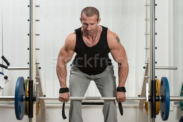 Bodybuilder Doing Heavy Weight Exercise For Back Stock photo © Jasminko