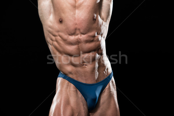 Bodybuilder Showing His Perfect Abs Stock photo © Jasminko