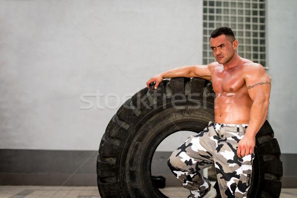 Muscular Man Resting After Tire Workout Stock photo © Jasminko