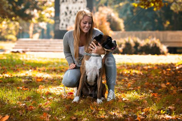 Mulheres jogar cão floresta sorridente masculino Foto stock © Jasminko