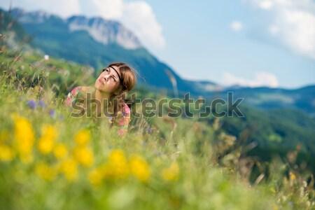 beautiful women laughing and lying on the grass Stock photo © Jasminko