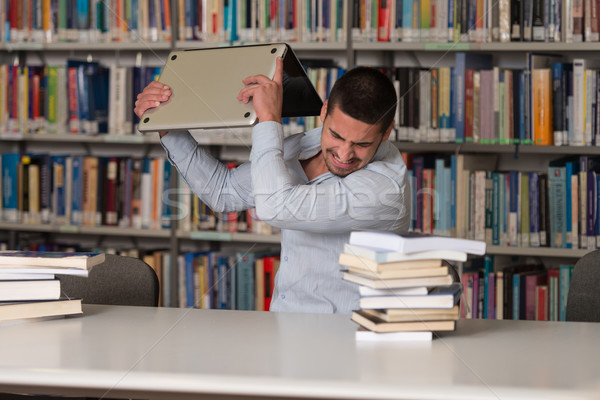 Furious Student Throwing His Laptop Away Stock photo © Jasminko