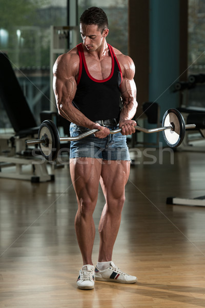 Homme gymnase biceps barbell musculaire Photo stock © Jasminko