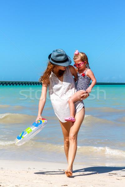 Mom daughter having a walk at the beach  Stock photo © javiercorrea15
